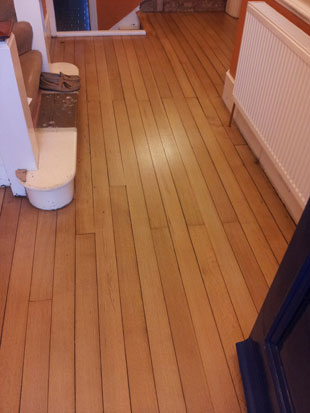 Other view of hall floor after sanding
