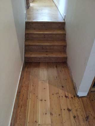 Sanded stairs and hallway, in Hackney, E8, after repair.